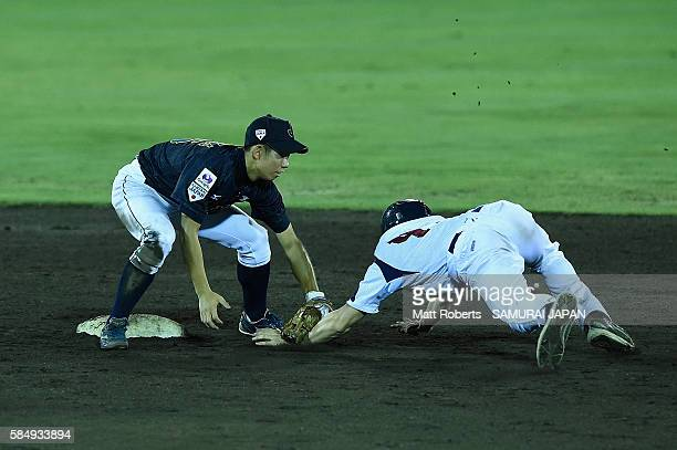 David Mares of Czech Republic is tagged out on second base by Shoki Koyama of Japan in the bottom half of the fourth inning in the game between Czech...