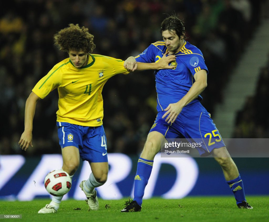 David Marinho of Brazil is challenged by Artem Milevskyy of Ukraine during the International Friendly match between Ukraine and Brazil at Pride Park Stadium on October 11, 2010 in Derby, England.