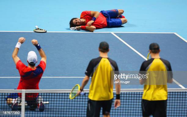 David Marrero and Fernando Verdasco of Spain celebrate victory in their men's doubles final match against Bob and Mike Bryan of the United States...