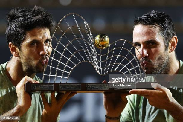 David Marrero and Fernando Verdasco of Spain kiss their trophy after defeating to Alexander Peya of Austria and Nikola Mektic of Croatia during the...