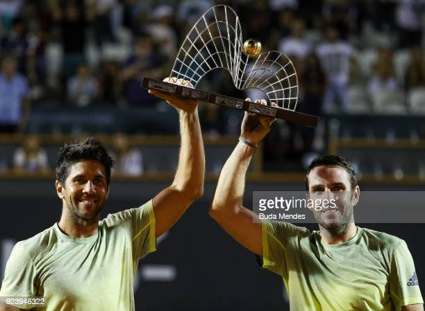 David Marrero and Fernando Verdasco of Spain raise their trophy after defeating to Alexander Peya of Austria and Nikola Mektic of Croatia during the...
