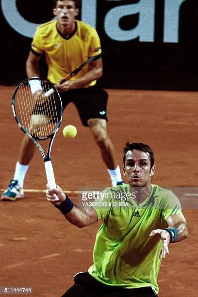 David Marrero and Pablo Carreno Busta of Spain play against Marcelo Melo and Bruno Soares of Brazil in the men's doubles semifinal match of the 2016...