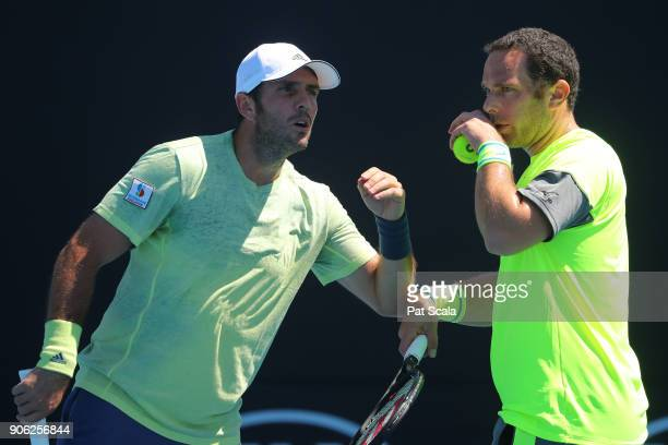 David Marrero of Spain and Scott Lipsky of the United States talk tactics in their first round men's doubles match against Michael Venus of New...