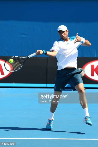 David Marrero of Spain plays a backhand in his men's first round match with Fernando Verdasco of Spain against James Duckworth of Australia and...