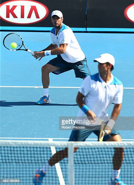 David Marrero of Spain plays a shot in his men's first round match with Fernando Verdasco of Spain against James Duckworth of Australia and Matthew...