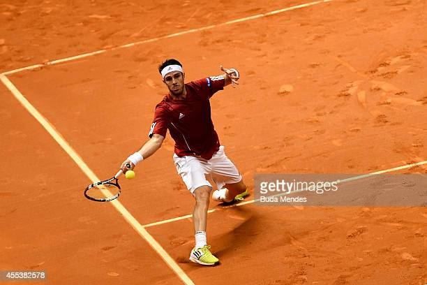 David Marrero of Spain returns a shot during his playoff doubles match against Bruno Soares and Marcelo Melo of Brazil on Day Two of the Davis Cup at...