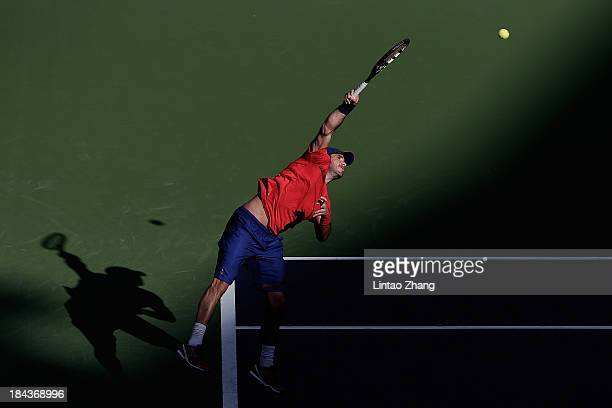 SHANGHAI CHINA OCTOBER David Marrero of Spain serves to Marcelo Melo of Brazil and Ivan Dodig of Croatia during the doubles final of the Shanghai...
