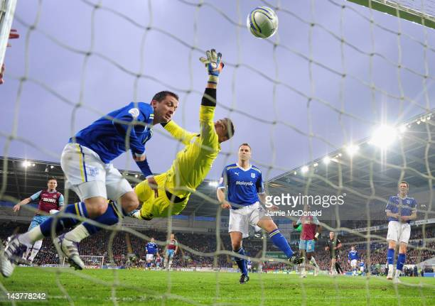 David Marshall of Cardiff fails to save from Jack Collison of West Ham United during the Npower Championship Playoff SemiFinal 1st leg match between...