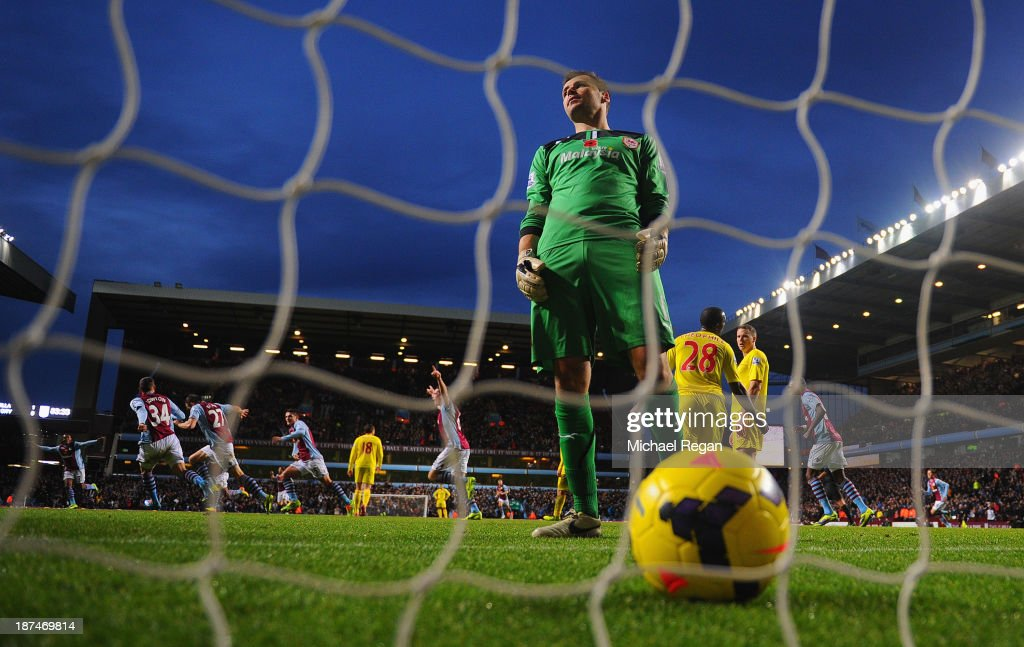 David Marshall of Cardiff looks dejected after Libor Kozak of Aston Villa scores his team's second goal past goalkeeper during the Barclays Premier League match between Aston Villa and Cardiff City at Villa Park on November 9, 2013 in Birmingham, England.