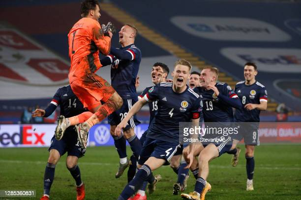 David Marshall of Scotland celebrates with Leigh Griffiths of Scotland and Scott McTominay of Scotland and his team as they celebrate after their...
