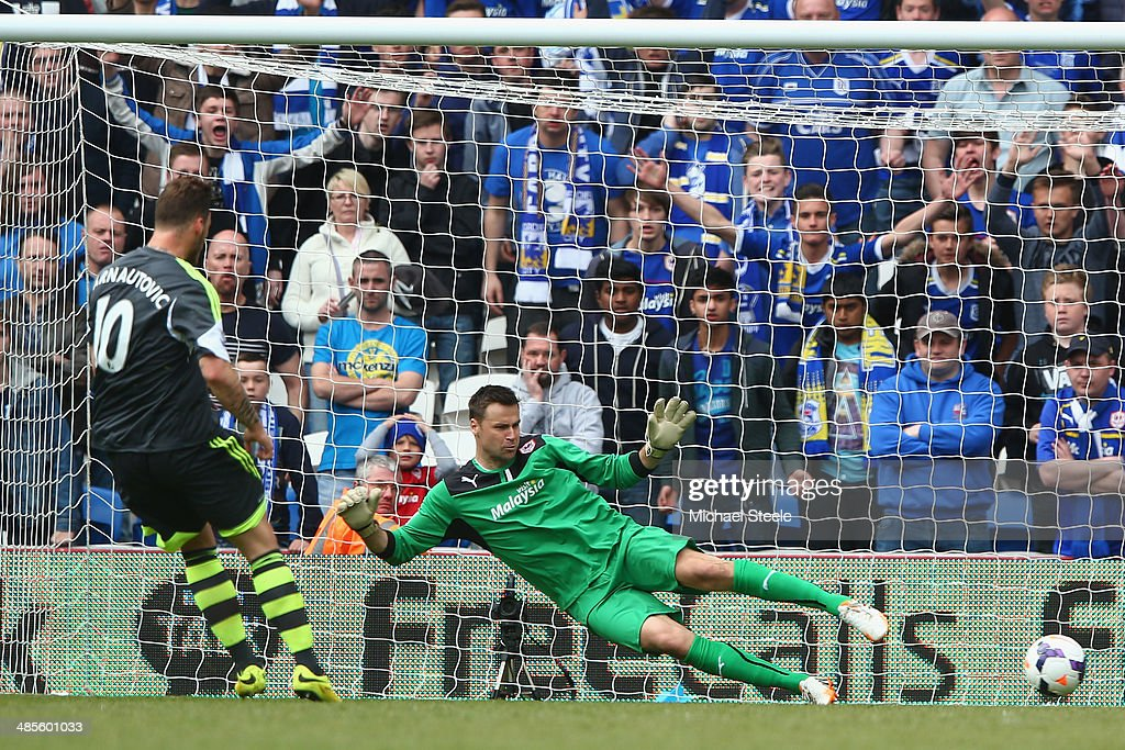 David Marshall the goalkeeper of Cardiff City dives the wrong way as Marko Arnautovic of Stoke City scores the opening goal from a penalty during the Barclays Premier League match between Cardiff City and Stoke City at the Cardiff City Stadium on April 19, 2014 in Cardiff, Wales.
