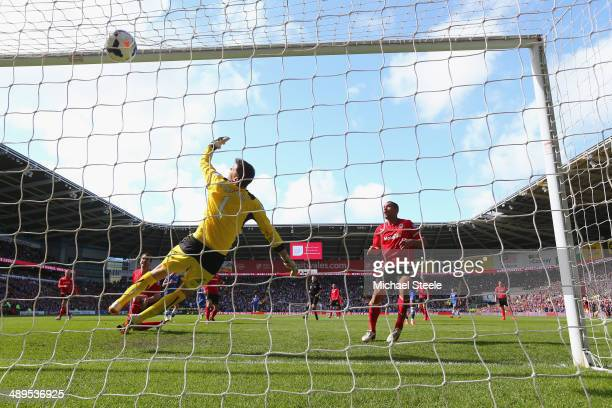 David Marshall the goalkeeper of Cardiff City is beaten by a shot from Andre Schurrle of Chelsea conceding the equalising goal during the Barclays...