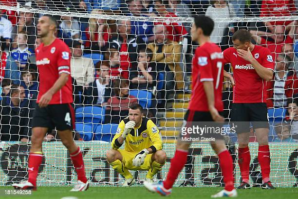 David Marshall the goalkeeper of Cardiff City is left distraught after conceding a last minute goal scored by Paulinho of Tottenham Hotspur during...