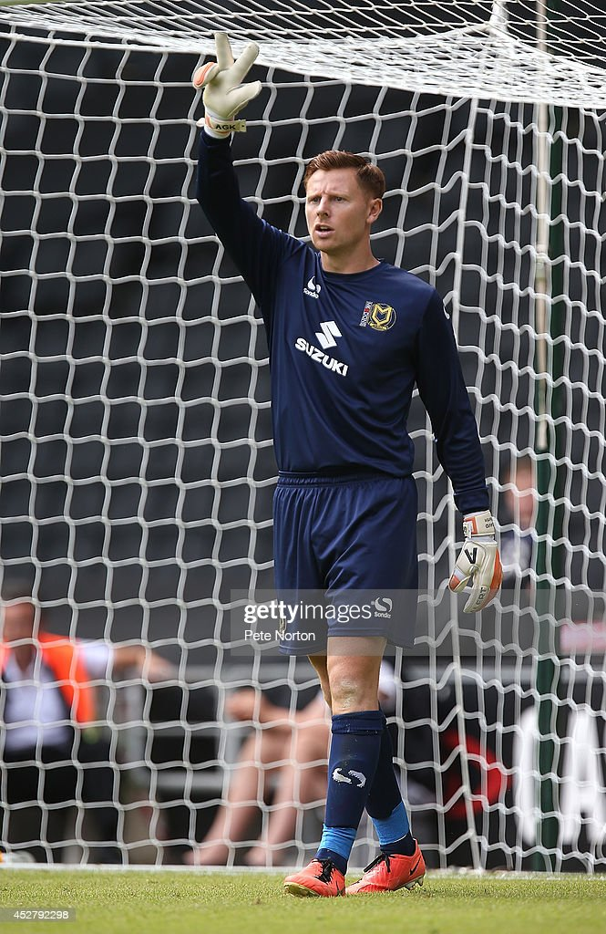 David Martin of MK Dons in action during the Pre-Season Friendly match between MK Dons and Nottingham Forest at Stadium mk on July 27, 2014 in Milton Keynes, England.