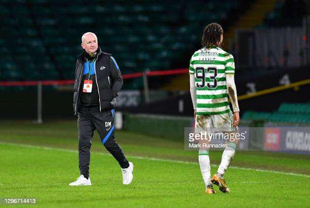 David Martindale, Manager of Livingston FC looks on as Diego Laxalt of Celtic walks past following the Ladbrokes Scottish Premiership match between...