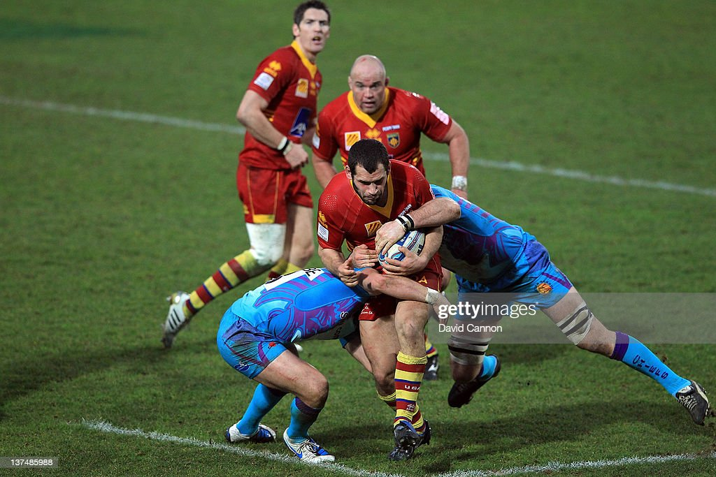 David Marty of Perpignan is tackled by John Andress of Exeter Chiefs during the Amlin Challenge Cup match between Exeter Chiefs and Perpignan at Sandy Park on January 21, 2012 in Exeter, England.