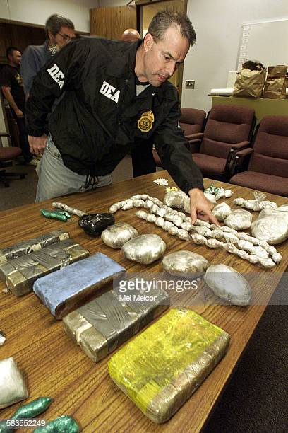 David Marzullo resident agent in charge of the DEA Ventura office looks at some of the confiscated drugs on display at Oxnard Police Dept The drugs...