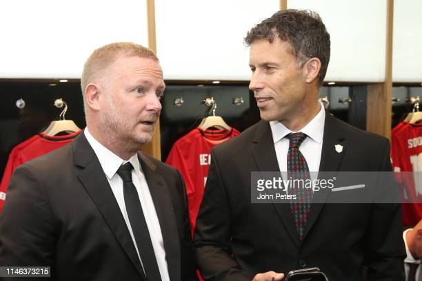 David May of Manchester United '99 Legends chats to Ronny Johnsen of Manchester United '99 Legends in the dressing room prior to the 20 Years Treble...