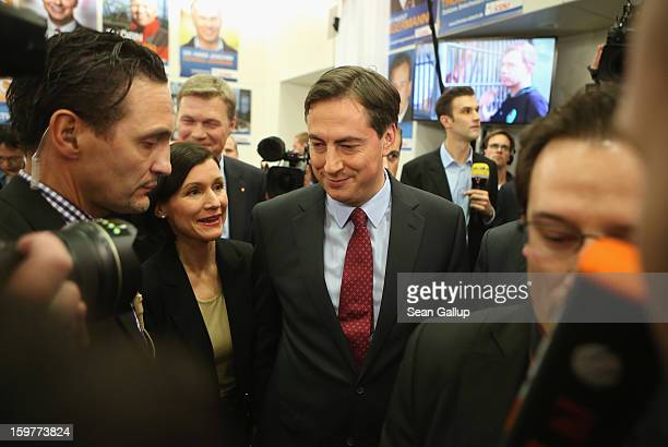 David McAllister incumbent gubernatorial candidate of the German Christian Democrats departs with his wife Dunja after speaking to supporters after...