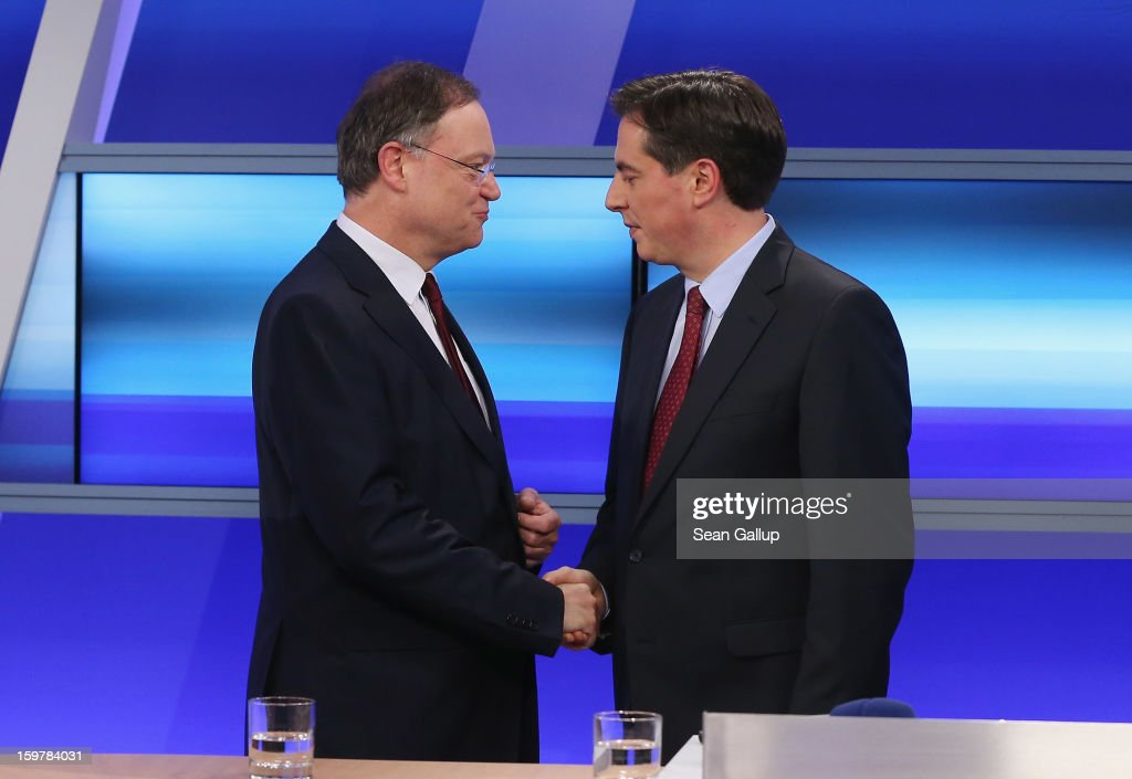 David McAllister (R), incumbent gubernatorial candidate of the German Christian Democrats (CDU), and Social Democrats (SPD) candidate Stephan Weil greet one another following a television news interview after initial poll results gave the CDU and SPD an even number opf seats with their respective coalition partners following elections in Lower Saxony on January 20, 2013 in Hanover, Germany. Many see the Lower Saxony election as a bellwether for national elections scheduled for later this year.