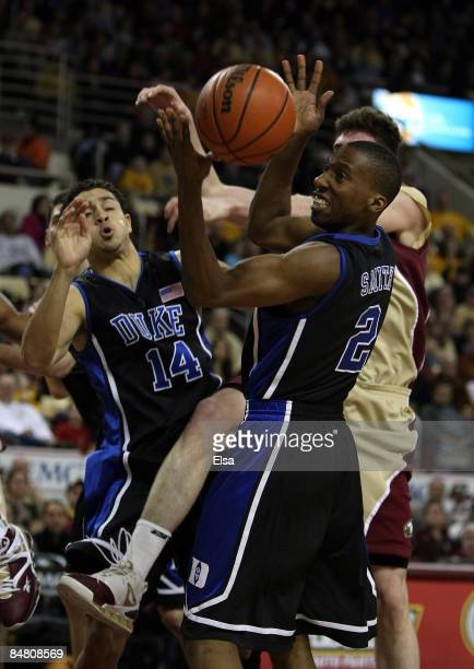 David McClure and Nolan Smith of the Duke Blue Devils fight for the rebound with Joe Trapani of the Boston College Eagles on February 15 2009 at...