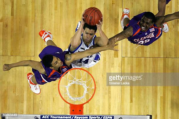 David McClure of the Duke Blue Devils goes up for a shot against David Potter and Sam Perry of the Clemson Tigers during the semifinals of the 2008...