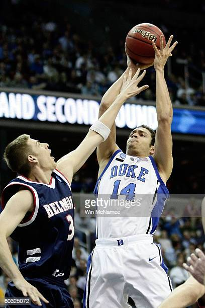 David McClure of the Duke Blue Devils shoots over Keaton Belcher of the Belmont Bruins during the first round of the West Regional as part of the...
