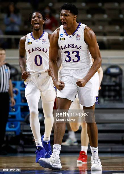David McCormack of the Kansas Jayhawks and Marcus Garrett of the Kansas Jayhawks react to a basket during the first half against the Eastern...