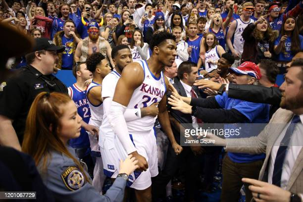 David McCormack of the Kansas Jayhawks is held back by Isaiah Moss during a brawl as the game against the Kansas State Wildcats ends at Allen...