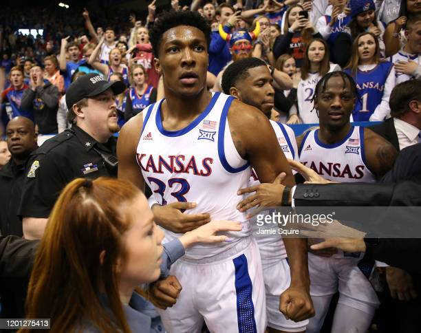 David McCormack of the Kansas Jayhawks is restrained by Isaiah Moss during a brawl as the game against the Kansas State Wildcats ends at Allen...