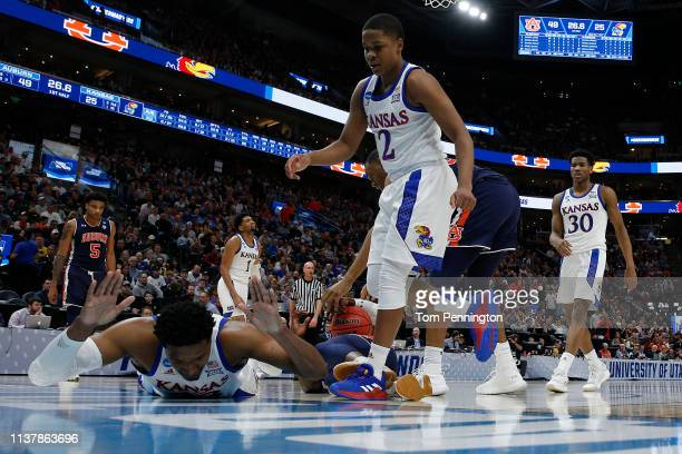 David McCormack of the Kansas Jayhawks reacts to a play against the Auburn Tigers during their game in the Second Round of the NCAA Basketball...