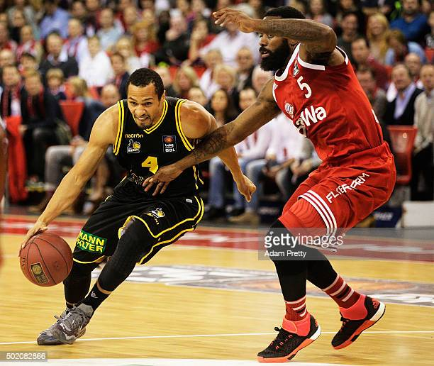 David McCray of Ludwigsburg is challenged by Kelvin Rivers of Bayern Muenchen during the Basketball match between FC Bayern Muenchen and MHP RIESEN...