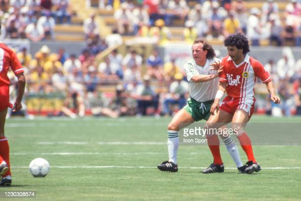 David MCCREERY of Northern Ireland and Djamel ZIDANE of Algeria during the 1986 FIFA World Cup match between Algeria and Northern Ireland at Estadio...