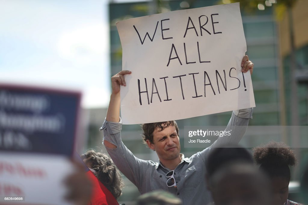 David McDougal joins others as they protest the possibility that the Trump administration may overturn the Temporary Protected Status for Haitians in front of the U.S. Citizenship and Immigration Services office on May 13, 2017 in Miami, Florida. 50,000 Haitians have been eligible for TPS and now the Trump administration has until May 23 to make a decision on extending TPS for Haitians or allowing it to expire on July 22 which would mean possibly deportation for the current TPS holders.