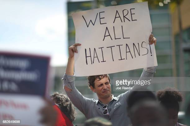 David McDougal joins others as they protest the possibility that the Trump administration may overturn the Temporary Protected Status for Haitians in...