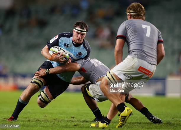 David McDuling of the Waratahs is tackled during the round nine Super Rugby match between the Waratahs and the Kings at Allianz Stadium on April 21...