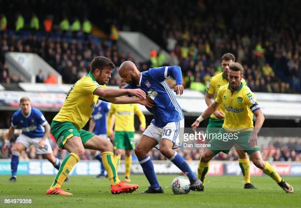 David McGoldrick of Ipswich and Grant Hanley of Norwich City battle for possession during the Sky Bet Championship match between Ipswich Town and...