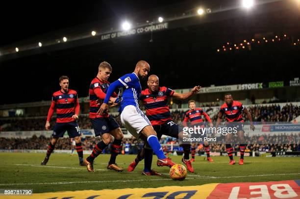 David McGoldrick of Ipswich Town and Alex Baptiste of Queens Park Rangers compete for the ball during the Sky Bet Championship match between Ipswich...