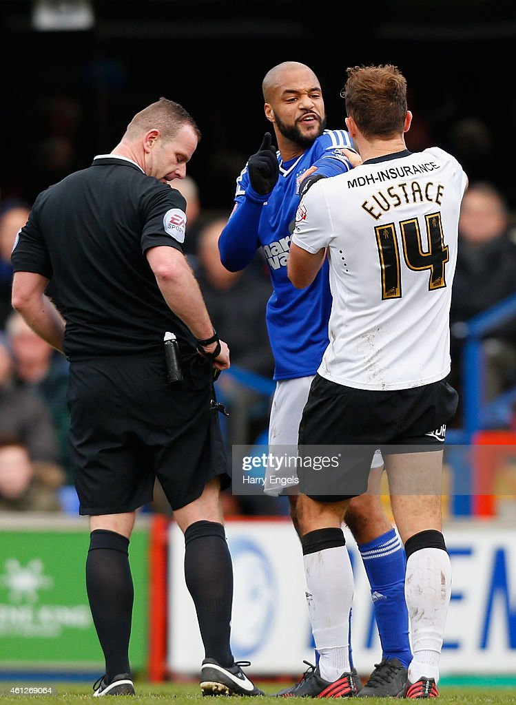 David McGoldrick of Ipswich Town and John Eustace of Derby County clash during the Sky Bet Championship match between Ipswich Town and Derby County at Portman Road on January 10, 2015 in Ipswich, England.