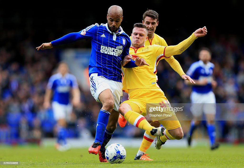 David McGoldrick of Ipswich Town and Kevin Long of MK Dons compete for the ball during the Sky Bet Championship match between Ipswich Town and Milton Keynes Dons at Portman Road on April 30, 2016 in Ipswich, England.