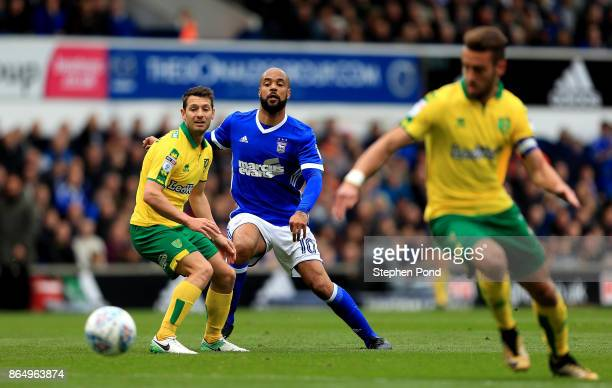 David McGoldrick of Ipswich Town and Wes Hoolahan of Norwich City compete for the ball during the Sky Bet Championship match between Ipswich Town and...