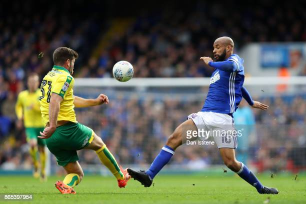 David McGoldrick of Ipswich Town battles for the ball with Grant Hanley of Norwich City during the Sky Bet Championship match between Ipswich Town...