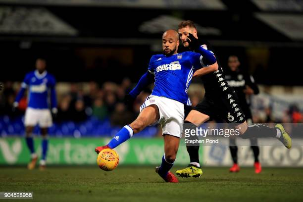 David McGoldrick of Ipswich Town controls the ball ahead of Liam Cooper of Leeds United during the Sky Bet Championship match between Ipswich Town...