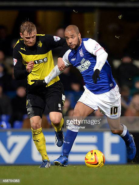 David McGoldrick of Ipswich Town is challenged by Joel Ekstrand of Watford during the Sky Bet Championship match between Ipswich Town and Watford at...