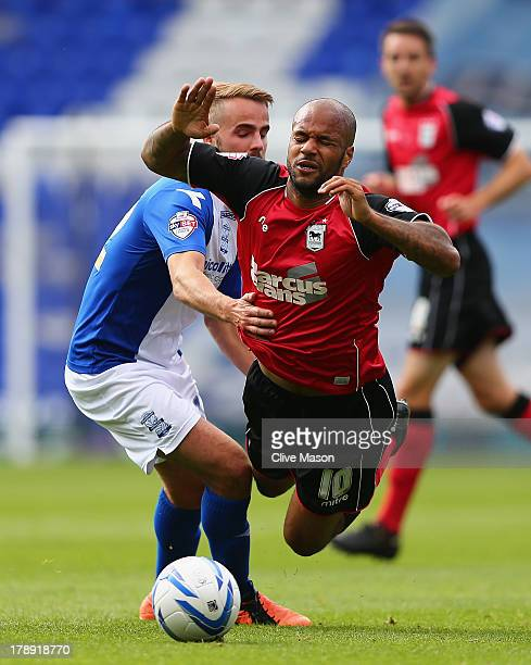 David McGoldrick of Ipswich Town is tackled by Andrew Shinnie of Birmingham City during the Sky Bet Championship match between Birmingham City and...