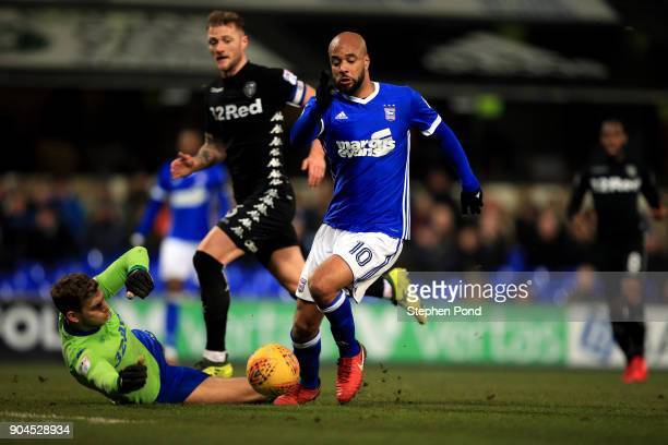 David McGoldrick of Ipswich Town take the ball around goalkeeper Felix Wiedwald of Leeds United during the Sky Bet Championship match between Ipswich...