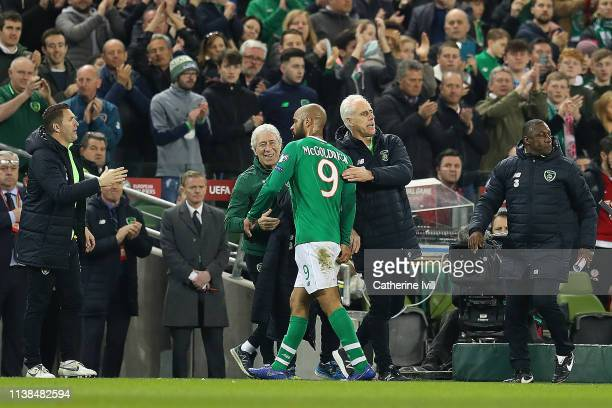 David McGoldrick of Ireland receives manager Mick McCarthy's applause after being substituted as assistants Robbie Keane and Terry O'Connor look on...