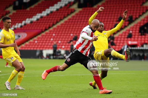 David McGoldrick of Sheffield United and Tosin Adarabioyo of Fulham during the Premier League match between Sheffield United and Fulham at Bramall...