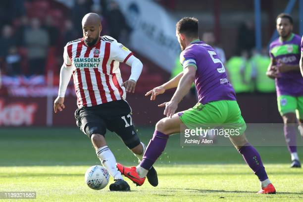 David McGoldrick of Sheffield United attempts to pass Bailey Wright of Bristol City during the Sky Bet Championship match between Sheffield United...