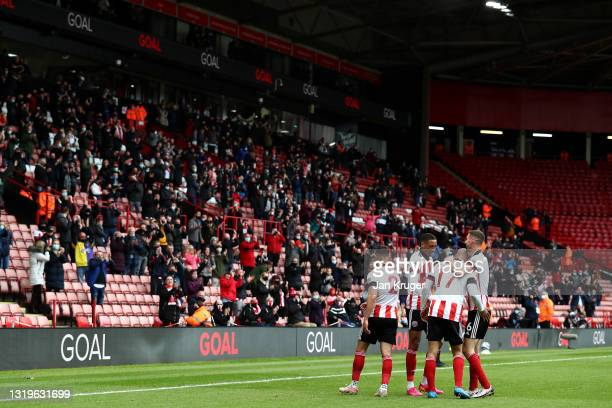 David McGoldrick of Sheffield United celebrates after scoring their team's first goal with his team mates during the Premier League match between...